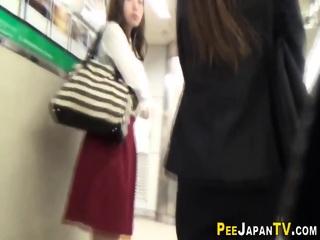 Hot asian sluts urinate in public